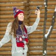 Pretty young woman using mobile phone outdoor — Stock Photo