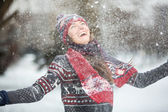 Happy young woman having fun on a snowy winter day outdoors — Photo