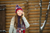 Happy woman phone talking outdoors in winter — Stock Photo