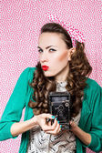 Woman with retro camera — Stock Photo