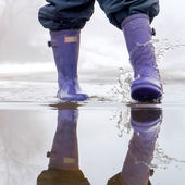 Jumping in a puddle — Foto de Stock