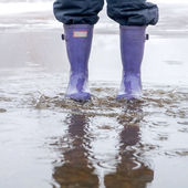 Jumping in a puddle — Stock Photo