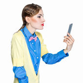 Young pretty woman holding cell phone — Stock Photo