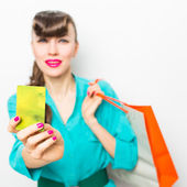 Beautiful girl with shopping bags and credit card — Stock Photo