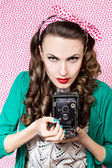 Style woman with old camera — Stock Photo