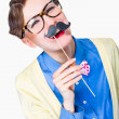 Funny cute girl with fake mustache — Stock Photo