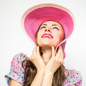 Surprised happy woman in hat — Stock Photo