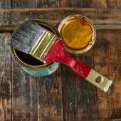 Protective varnish and a brush — Stock Photo