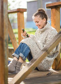 Young woman texting with her phone — Stock Photo