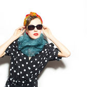 Fashion woman in scarf and sunglasses — Stock Photo