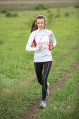 Running woman in summer — Stock Photo