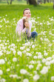 Happy young woman in the field — Stock Photo