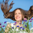 Beautiful woman with flying hair — Stock Photo