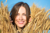 Happy young woman in field — Stock Photo