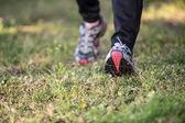 Closeup running legs — Stock Photo