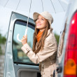 Young happy woman near car — Stock Photo