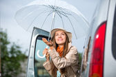 Young happy woman car umbella — Stock Photo
