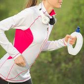 Female runner jogging — Stock Photo