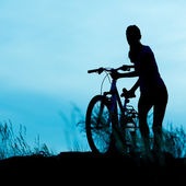 Bicycle rider at sunset — Stock fotografie