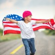Happy boy with American flag — Stock Photo