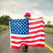 Happy child with American flag — Stock Photo