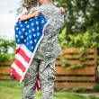 Father hugs his son. American family — Stock Photo