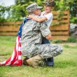Father hugs his son. American family — Stock Photo #48621531