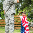 American soldier and his son salute each other — Stock Photo #48621587