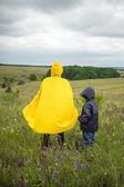 Family walking hiking on a rainy day — Stock Photo