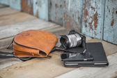 Photo camera, digital tablet and black smartphone — Stock Photo