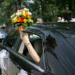 Bride in a car — Stock Photo