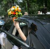 Bride in a car — Stock Photo