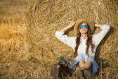 Sexy fashion woman in hat and sunglasses — Stock Photo