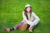 Young woman sitting on green grass enjoy nature — Stock Photo