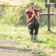 Woman sliding on a zip line — Stock Photo #50127631