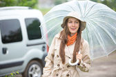 Young happy woman with umbrella — Stock Photo