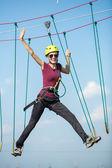 Woman climbing over blue sky — Stock Photo