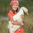 Woman farmer holds goose happy smiling — Stock Photo #50332235