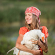 Beautiful girl holding goose — Stock Photo #50332237