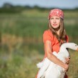Young woman care about animal goose — Stock Photo #50332241
