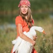 Young woman care about animal goose — Stock Photo #50332245