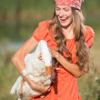 Funny portrait of woman with a goose — Stock Photo #50332265