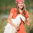 Woman farmer holds goose happy smiling — Stock Photo #50332271