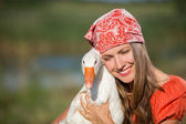 Funny portrait of woman with a goose — Stock Photo