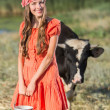 Smiling young farmer carrying fresh milk — Foto Stock