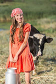 Smiling young farmer carrying fresh milk — Stock Photo