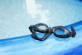 Glasses for swimming on swimming pool — Stock Photo