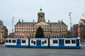 Tram in front of Amsterdam grand palace — Stock Photo