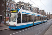 Tram in the streets of Amsterdam — Stock Photo