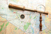 Arrangement of Map, Hand held Telescope, compass and magnifying glass — Stock Photo